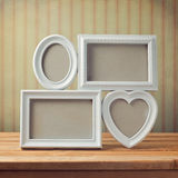 Picture frame on wooden table over vintage background. Ready for product montage Stock Photo