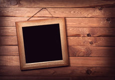 Picture frame on wooden wall Royalty Free Stock Image