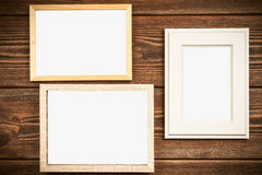 Picture frame on a wooden wall Stock Images