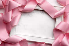 Picture frame wrapped in gift ribbon Stock Photo
