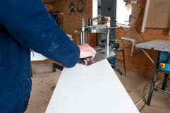 Picture framer working with the underpinner . Picture framer working with the underpinner in a small workshop Royalty Free Stock Photos