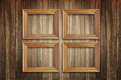 Picture frames. Four picture frames on wood background Royalty Free Stock Photos