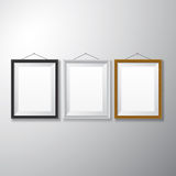 Picture Frames Black White Wooden. Variety types of realistic vertical picture frames with empty space  on white background for presentation and showcasing Royalty Free Stock Photography