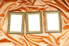 Picture frames on the color satin Royalty Free Stock Photography