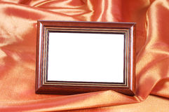 Picture frames on the color satin background Stock Photos