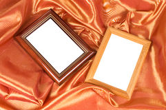 Picture frames on the color satin background. Picture frames on the color satin Royalty Free Stock Photos