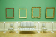 Picture frames in green room of museum Stock Photos