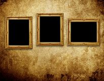 Picture frames on grunge wall Stock Photos