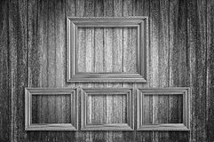 Picture frames on the old wall. Four photo frames on old wood background Stock Photography