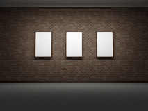 Picture frames or photos on the dark bricks wall of the room Royalty Free Stock Photos