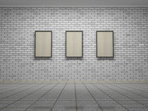 Picture frames or photos on the white bricks wall of the room Royalty Free Stock Image