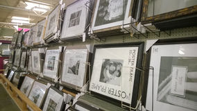 Picture frames  on shelves selling Royalty Free Stock Images