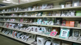 Picture frames  on shelves selling at store. Picture frames on shelves selling at the store Garden Ridge, USA Royalty Free Stock Images