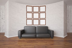 Picture frames and sofa. Front view of small empty picture frames organized into big square and leather sofa on abstract concrete wall background. Mock up, 3D Royalty Free Stock Images
