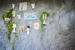 Picture frames and vases on the wall Stock Photography