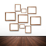 Picture frames on the wall inside the room Stock Images