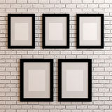 Picture frames on white wall Stock Photos