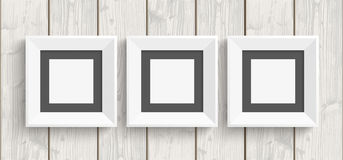 3 Picture Frames Wood. Wooden background with 3 picture frames Stock Photo