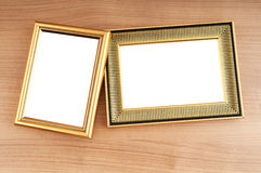 Picture frames on the wooden background Stock Photos