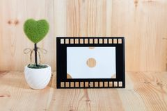 Picture frames on the wooden floor. Background concept green hert Stock Photography