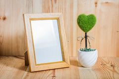 Picture frames on the wooden floor. Concept design frames. have hert green Royalty Free Stock Photos