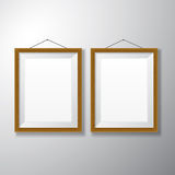 Picture Frames Wooden Vertical. Realistic vertical wooden picture frames with empty space  on white background for presentation and showcasing purposes Royalty Free Stock Photography