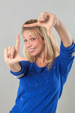 Picture framing concept for cheeky young blond woman Stock Photo