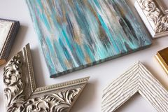 Picture framing. Decorative wooden frames for picture. Choosing the frame for a painting stock photos