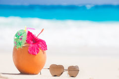 Picture of fresh coconut juice and sunglasses on Royalty Free Stock Photo