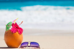 Picture of fresh coconut juice and sunglasses on tropical beach Stock Photography