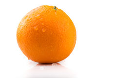 A picture of a fresh orange with water drops isolated on white Royalty Free Stock Photos
