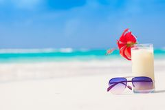 Picture of fresh pina colada and sunglasses on Stock Photos