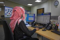 Free Picture From Back For Saudi Man Working In The Office Wearing A Shemagh Royalty Free Stock Photo - 187739135