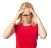 A picture of a frustrated woman. Holding her head over white background Stock Image