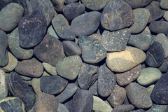 Picture full of stone pebbles under water lake bed background Stock Photo