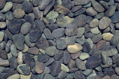 Picture full of stone pebbles under water lake bed background Royalty Free Stock Photos