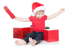 Picture of funny child opening christmas present Stock Photos