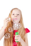 Picture of funny little girl blowing soap bubbles Stock Image