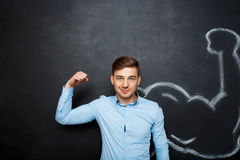 Picture of  funny man with  fake muscle arm Royalty Free Stock Photography