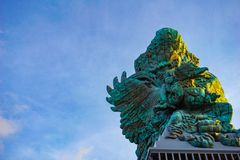 Picture of Garuda statue as Bali landmark with blue sky as a background. Balinese traditional symbol of hindu religion. Landscape picture of Garuda statue as stock photos