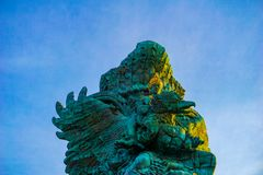 Picture of Garuda statue as Bali landmark with blue sky as a background. Balinese traditional symbol of hindu religion. Landscape picture of Garuda statue as stock image