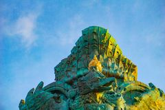 Picture of Garuda statue as Bali landmark with blue sky as a background. Balinese traditional symbol of hindu religion. Landscape picture of Garuda statue as royalty free stock photos