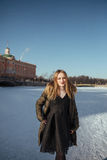Picture of a girl against a background of snow Royalty Free Stock Photos