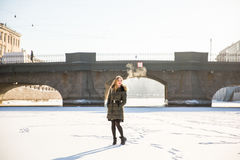 Picture of a girl against a background of snow Stock Images