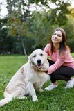 Picture of girl with dog on lawn in summer park Royalty Free Stock Images