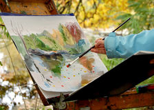 Picture. Girl draws a picture of autumn landscape Royalty Free Stock Photos