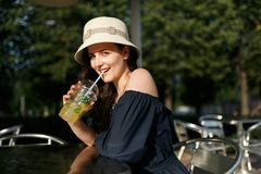 Picture of girl in hat with glass Royalty Free Stock Image