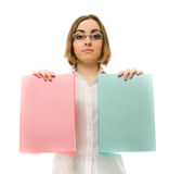 Picture of a girl in white holding two folders Royalty Free Stock Image
