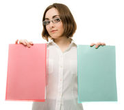Picture of a girl in white holding two folders Royalty Free Stock Images