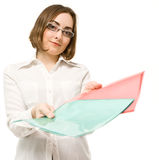 Picture of a girl in white offering two folders Stock Photography